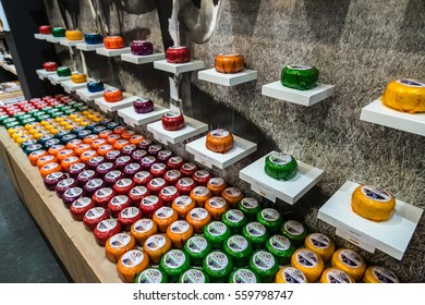 AMSTERDAM, THE NETHERLANDS - JUNE 16, 2016: Cheese wheels on the shelves in Amsterdam store, The Netherlands on June 16, 2016
