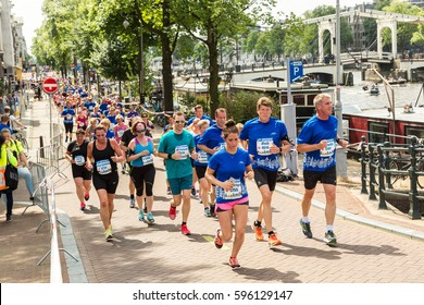 AMSTERDAM, THE NETHERLANDS - JUNE 16, 2016: The Amsterdam Marathon in Amsterdam in a beautiful summer day, The Netherlands on June 16, 2016