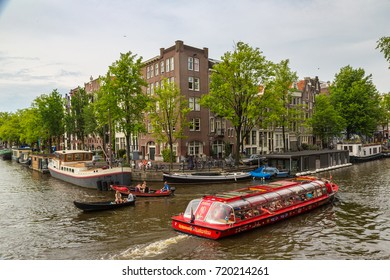 AMSTERDAM, THE NETHERLANDS - JUNE 16, 2016: Canal in Amsterdam in a beautiful summer day. Amsterdam is the capital and the most populous city of the Netherlands on June 16, 2016