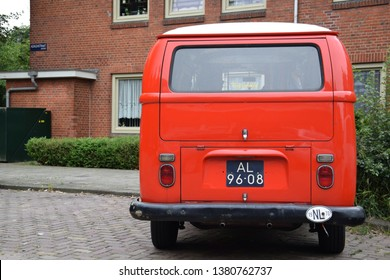 AMSTERDAM; THE NETHERLANDS - JUNE 16, 2018: A dark red Volkswagen Type 2 T2 known officially as the Transporter, Kombi or Microbus, or, informally, as the Bus or Camper