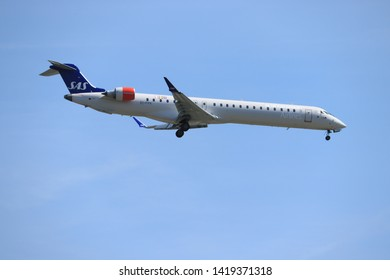 Amsterdam, the Netherlands - June, 1st 2019: EI-FPK SAS Scandinavian Airlines Bombardier CRJ-900 final approaching to Polderbaan runway at Schiphol Amsterdam Airport, the Netherlands
