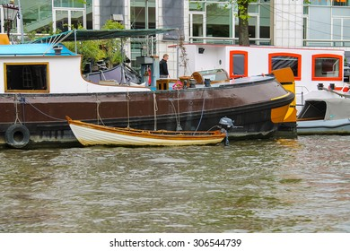 Amsterdam, Netherlands - June 20, 2015: Boats on a canal in Amsterdam. Netherlands