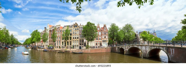 AMSTERDAM, THE NETHERLANDS - JUNE 20, 2015: Panorama of Amsterdam canal Prinsengracht with typical houses and boats on a sunny day