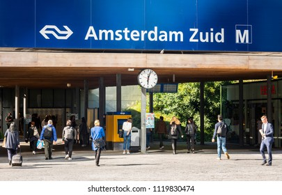 Amsterdam, The Netherlands - June 20, 2018: People at the NS train  station and subway station at Amsterdam Zuid, Netherlands.