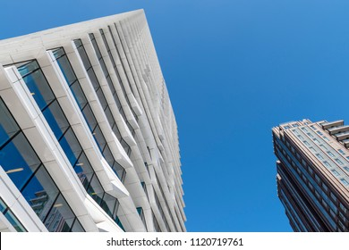 Amsterdam, Netherlands - June 20, 2018: High, architectural office buildings on the Zuidas in Amsterdam Zuid, The Netherlands, in the summer with blue sky.