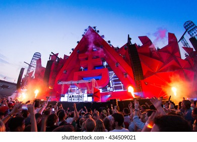 Amsterdam, the Netherlands - June 2016 - The Flying Dutch - Party crowd in front of the stage with DJ Armin van Buuren