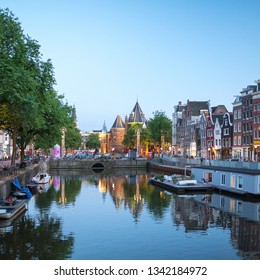 AMSTERDAM, NETHERLANDS - JUNE, 2018: Most famous canals and embankments of Amsterdam. General view of the cityscape and traditional Netherlands architecture.
