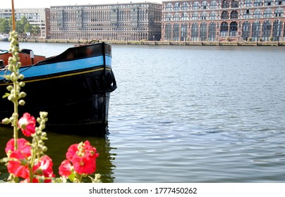 AMSTERDAM, THE NETHERLANDS – JUNE 24 2020: View on the Eastern Quay (Oostelijke Handelskade), located on the IJ harbour as seen from Java-island. a peninsula in the IJ in the Eastern Docklands