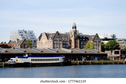 AMSTERDAM, THE NETHERLANDS – JUNE 24 2020: View on the Lloyd hotel built in 1921 by the Royal Dutch Lloyd shipping company on the Eastern Quay (Oostelijke Handelskade), located on the IJ harbour