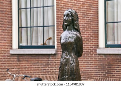 AMSTERDAM, NETHERLANDS - JUNE 25, 2017: Anne Frank statue on Westerkerk Plaza near the Anne Frank House. Anne Frank was a German-born diarist. One of the most discussed Jewish victims of the Holocaust