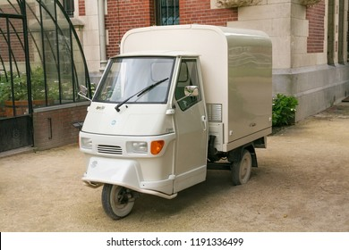 AMSTERDAM, NETHERLANDS - JUNE 25, 2017: View of a moto car Piaggio Ape 50. The Piaggio Ape is a three-wheeled light commercial vehicle based on a vespa scooter produced since 1948 by Piaggio.
