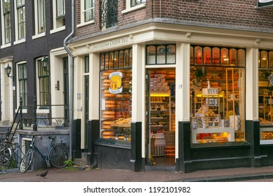 AMSTERDAM, NETHERLANDS - JUNE 25, 2017: Entrance to the Cheese Deli shop on the Oudezijds Voorburgwal street in the historical part of Amsterdam.