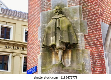 AMSTERDAM, NETHERLANDS - JUNE 25, 2017: Sculpture of the Hugo de Groot (Grotius) by sculptor Lambertus Zijl on the Oudebrugsteeg st. Hugo Grotius was a famous Dutch jurist of the XVII century.