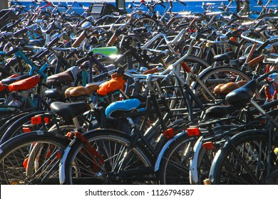 Amsterdam, the Netherlands, June 29, 2018: Hundreds of bikes on a parking near Amsterdam Central station. Bicycles are one of the most popular type of transport in Benelux countries.