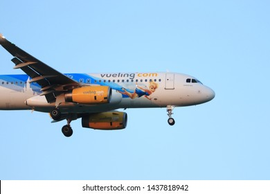 """Amsterdam, the Netherlands - June, 29th 2019: EC-MLE Vueling Airbus A320-200 """"Disneyland Paris - 25 Years"""" livery, final approaching to Polderbaan runway at Schiphol Amsterdam Airport, the Netherlands"""