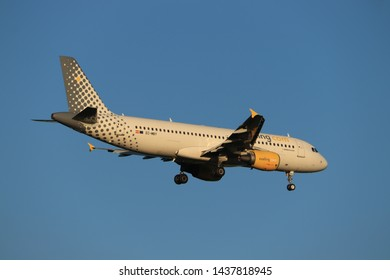 Amsterdam, the Netherlands - June, 29th 2019: EC-MBY Vueling Airbus A320-200 final approaching to Polderbaan runway at Schiphol Amsterdam Airport, the Netherlands