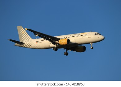 Amsterdam, the Netherlands - June, 29th 2019: EC-LAA Vueling Airbus A320-200 final approaching to Polderbaan runway at Schiphol Amsterdam Airport, the Netherlands