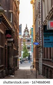 Amsterdam, Netherlands - June 30, 2019: The historic city center. Old houses of the city. Wijde Kapelsteeg Street