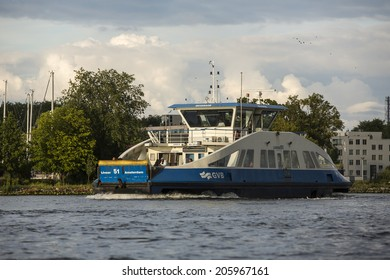 Amsterdam, Netherlands - June 30: Ferry boat on the water canals of Amsterdam, Netherlands, on June 30, 2014.