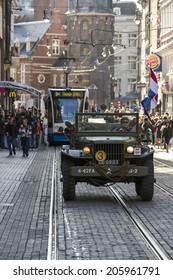 Amsterdam, Netherlands - June 30: A vintage army vehicle on the streets of Amsterdam, Netherlands on June 30, 2014.