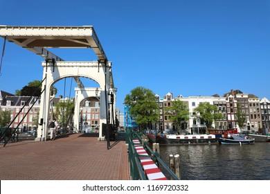 AMSTERDAM, NETHERLANDS - JUNE 6, 2018: bridge Magere Brug (Skinny bridge) on Amstel river, Amsterdam, Netherlands