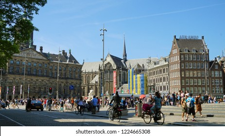 AMSTERDAM, NETHERLANDS - JUNE 6, 2018: Dam square with Royal Palace, Nieuwe Kerk church and ABN-AMRO sign bank on old building in Amsterdam, Netherlands