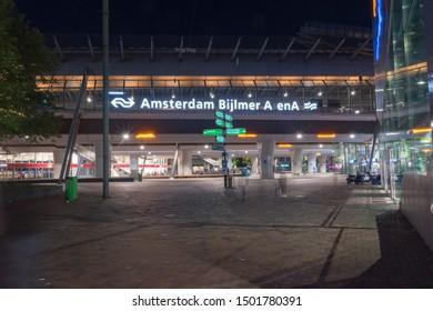 Amsterdam, Netherlands - June 6, 2019: Amsterdam Bijlmer ArenA railway station at night.