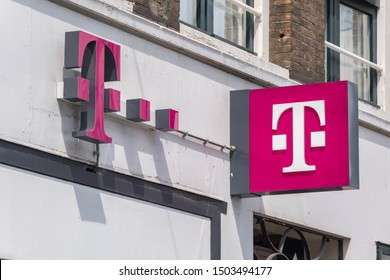 Amsterdam, Netherlands - June 7, 2019: Logo of T-Mobile on the store. T-Mobile is the brand name Deutsche Telekom, founded at 1999.