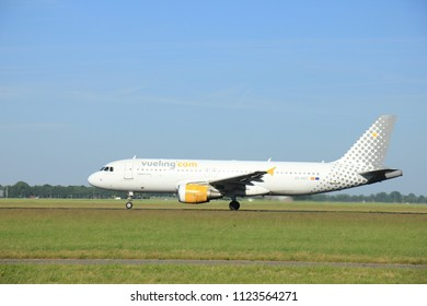 Amsterdam, the Netherlands - June 9th 2016: EC-KDT Vueling Airbus A320-216, take off from Polderbaan runway Schiphol, destination Milan, Italy