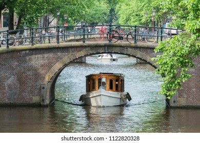 Amsterdam, the Netherlands, luxury canal bus and bridge