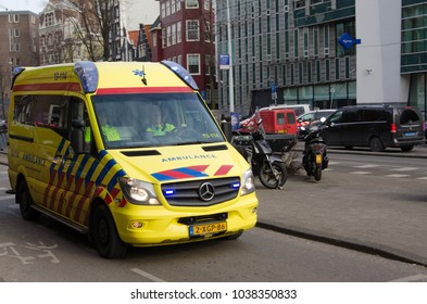 Amsterdam, The Netherlands - March 01, 2018 - A dutch ambulance driving through the centre of Amsterdam