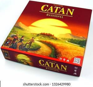 Amsterdam, the Netherlands - March 1, 2019: Dutch board game Catan against a white background.