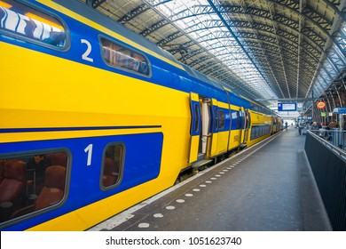 AMSTERDAM, NETHERLANDS, MARCH, 10 2018: Interior view ofAmsterdam Schiphol train station, passengers at the station. Historical and big train station