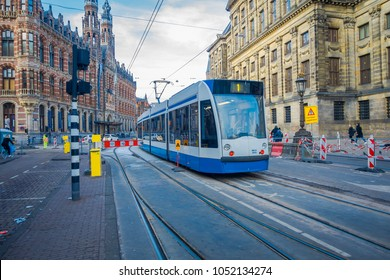 AMSTERDAM, NETHERLANDS - MARCH 10, 2018: Gorgeous outdoor view of Amsterdam Tram is a tram network it has been operated by municipal public transport operator GVB, Amsterdam