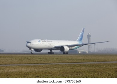 AMSTERDAM, THE NETHERLANDS - MARCH, 11. A Boeing 777-3U3(ER) of Garuda Indonesia takes off at Amsterdam Airport Schiphol (The Netherlands, AMS) on March 11, 2016. The name of the runway is Polderbaan.