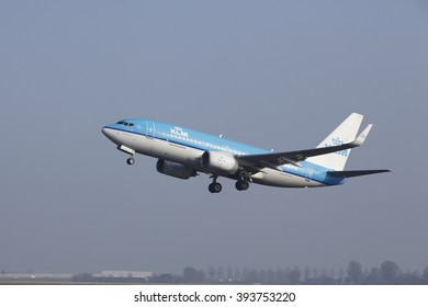 AMSTERDAM, THE NETHERLANDS - MARCH, 11. A Boeing 737-7K2 of KLM takes off at Amsterdam Airport Schiphol (The Netherlands, AMS) on March 11, 2016. The plane is already high in the air.