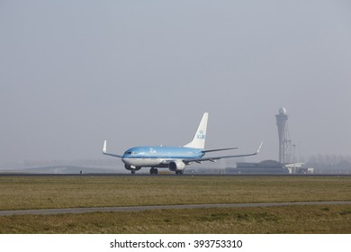 AMSTERDAM, THE NETHERLANDS - MARCH, 11. A Boeing 737-7K2 of KLM takes off at Amsterdam Airport Schiphol (The Netherlands, AMS) on March 11, 2016. The name of the runway is Polderbaan.