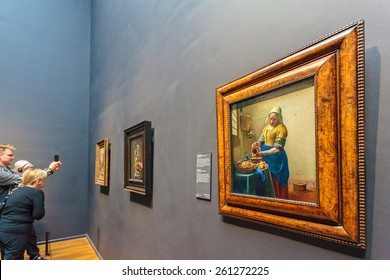 AMSTERDAM, THE NETHERLANDS - MARCH 12, 2015: Oil Painting of The Milkmaid by Johannes Vermeer from 1658 in the famous Rijksmuseum in Amsterdam at the museumplein, The Netherlands