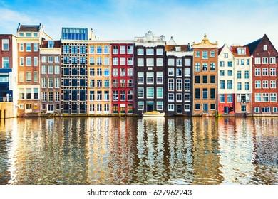 Amsterdam, Netherlands - March 12, 2017. Traditional dutch houses on canal in Amsterdam, Netherlands