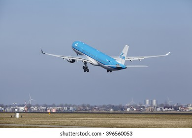 AMSTERDAM, THE NETHERLANDS - MARCH, 13. The KLM Airbus A330-303 with identification PH-AKF takes off at Amsterdam Airport Schiphol (The Netherlands, AMS), Polderbaan on March 13, 2016.