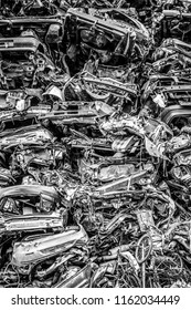 AMSTERDAM, NETHERLANDS - MARCH 15, 2016: Piled up compressed cars as industrial background black-white photo. March 15, 2016 in Amsterdam - Netherland.