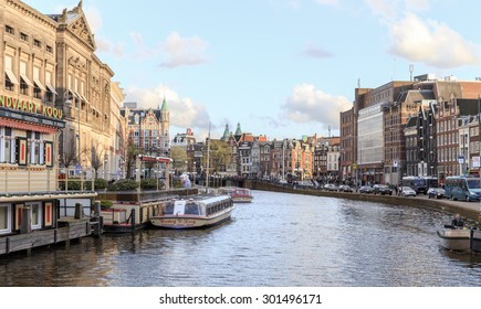 AMSTERDAM, NETHERLANDS - MARCH 15: Streets of the city with canals, on March 15, 2014 in Amsterdam