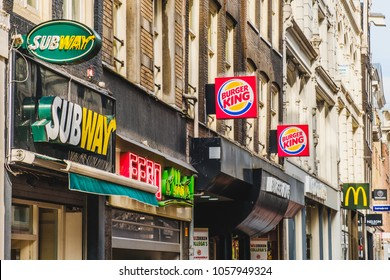 Amsterdam, Netherlands - march 2018: Fastfood chain brand logos of Subway, Mcdonald and Burger King in City center of Amsterdam