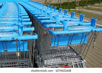 Amsterdam, The Netherlands - March 22, 2018: Row of blue Albert Heijn shopping carts or trolleys. Albert Heijn is the largest Dutch supermarket chain.