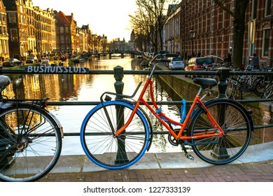 Amsterdam, Netherlands - March 24, 2018 - Street view of Amsterdam city with local house and canal