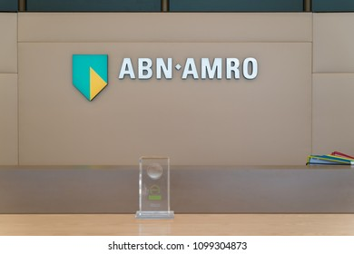 AMSTERDAM, NETHERLANDS - MARCH 25, 2017: Famous ABN-AMRO logo on a counter in the Dutch headquarters