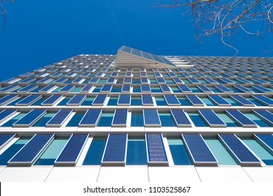 AMSTERDAM, NETHERLANDS - MARCH 25, 2017: Modern eco office building exterior with solar panels on its facade