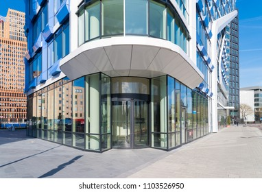AMSTERDAM, NETHERLANDS - MARCH 25, 2017: Entrance of a modern office building on the south axis, the capital's business district