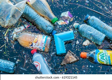 AMSTERDAM, THE NETHERLANDS - MARCH 27, 2017: Plastic waste floating in a canal in Amsterdam, The Netherlands