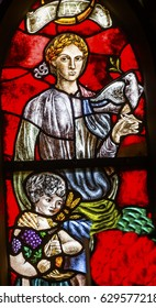 AMSTERDAM, NETHERLANDS - MARCH 30, 2017 Peace Woman Child Dove Stained Glass Window De Krijtberg Church Amsterdam Holland Netherlands.